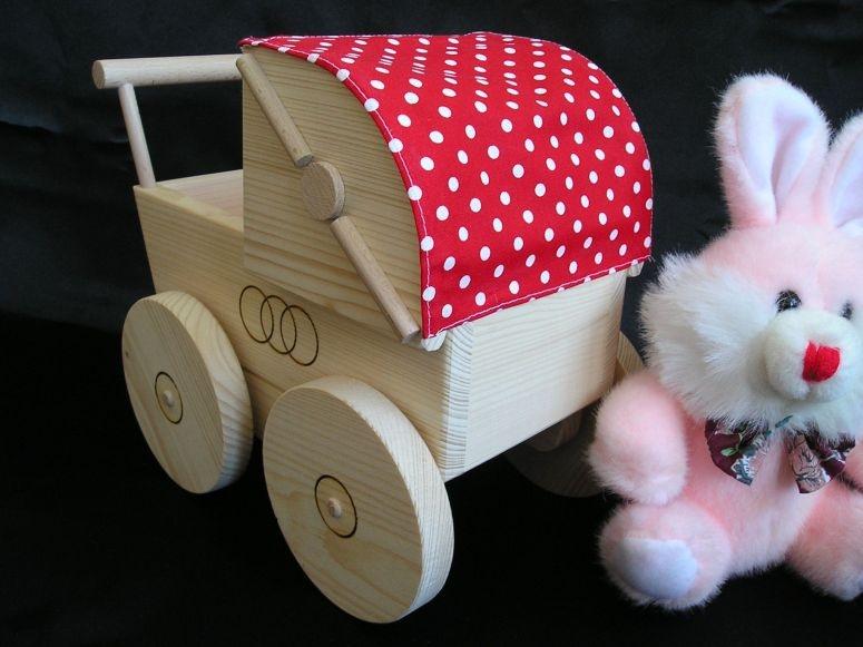 Kinderwagen-Puppe-spielzeug