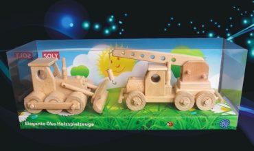 Kranspielzeug aus Holz Bulldozer und Kran in einer Geschen